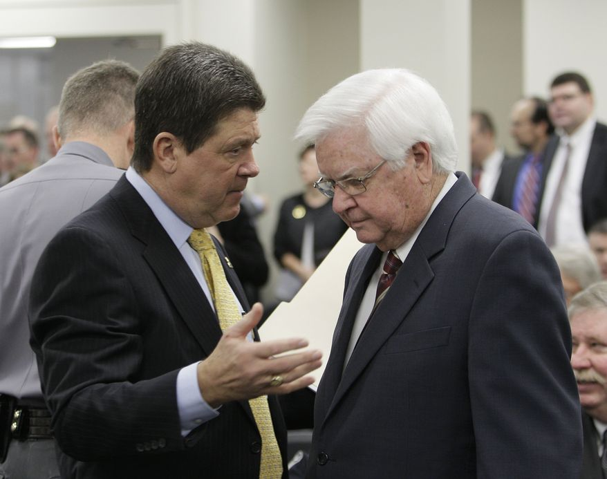 U.S. Rep. Hal Rogers, R-Kentucky, right, listens to House Speaker Greg Stumbo, D-Prestonsburg, prior to their testimony in front of a Senate panel in Frankfort, Ky., on Thursday, Feb. 3, 2011. Both men testified in favor of a bill that would require a prescription for certain cold medications. (AP Photo/Ed Reinke)