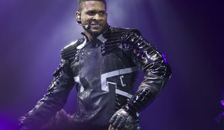 Musician Usher performs in London on Wednesday, Feb. 2, 2011. (AP Photo/Joel Ryan )