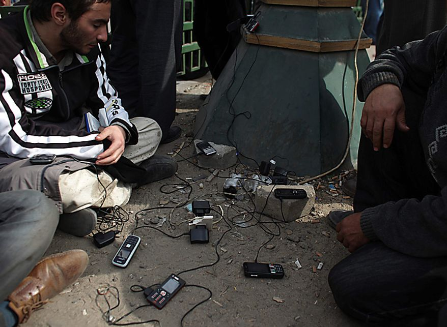 Anti-government demonstrators recharge their cellular phones in Cairo's main square Thursday, Feb. 3, 2011. (AP Photo/Tara Todras-Whitehill)