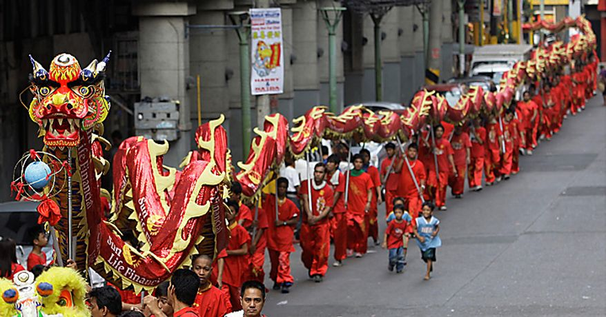 Filipino performers carry a long Chinese Dragon as they parade around Manila's Chinatown to celebrate the Chinese lunar new year on Thursday Feb. 3, 2011. This year is the Year of the Rabbit according to the Chinese calendar. (AP Photo/Aaron Favila)