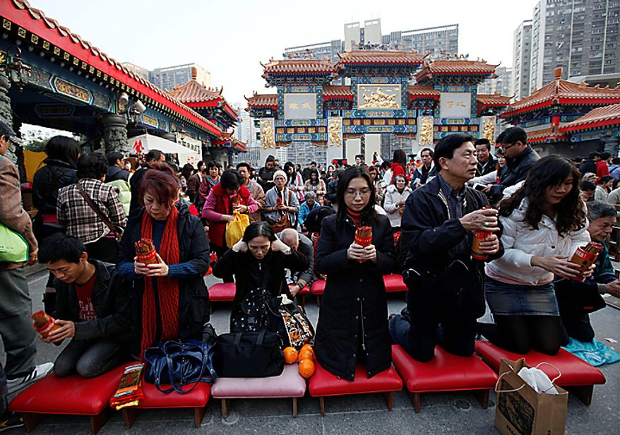 Worshippers divine by drawing lots during the China's Lunar New Year at the Wong Tai Sin Temple in Hong Kong Thursday, Feb. 3, 2011. According to the Chinese zodiac, 2011 is the Year of the Rabbit. (AP Photo/Kin Cheung)