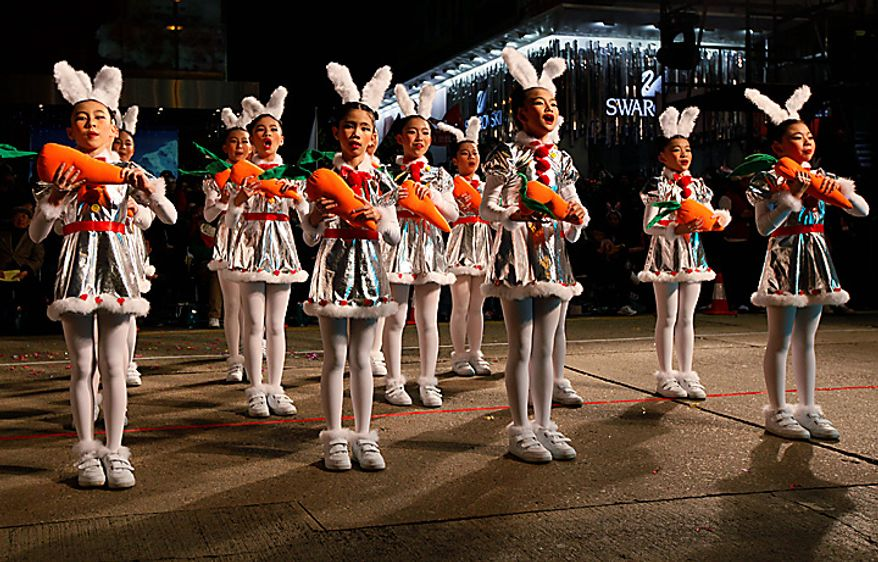 Performers are dressed as rabbits during the night parade in Hong Kong Thursday, Feb. 3, 2011 as they celebrate China's lunar new year. According to the Chinese Zodiac, 2011 is the Year of the Rabbit. (AP Photo/Kin Cheung)