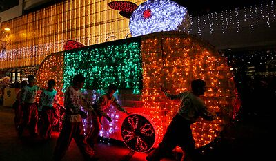 Performers push a rabbit-shaped decorated float during the night parade in Hong Kong Thursday, Feb. 3, 2011 as they celebrate China's lunar new year. According to the Chinese Zodiac, 2011 is the Year of the Rabbit. (AP Photo/Kin Cheung)