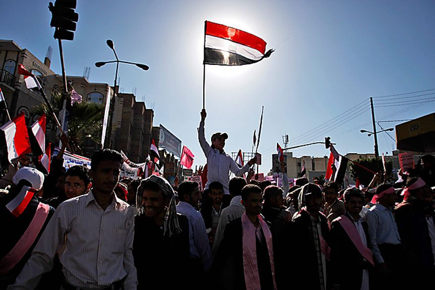 A Yemeni demonstrator waves the national flag during a demonstration against the government, in Sanaa, Yemen, Thursday, Feb. 3, 2011. Thousands of opponents of Yemen's government and its supporters demonstrated in the capital and other cities a day after the president pledged not to seek another term in office. (AP Photo/Hani Mohammed)