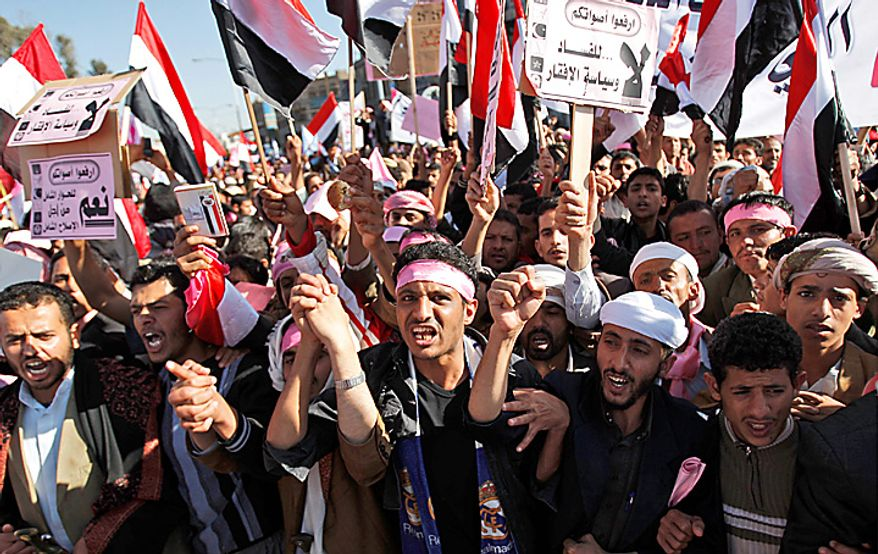 "Yemenis chant slogans and hold banners during a demonstration against the government, in Sanaa, Yemen, Thursday, Feb. 3, 2011. Thousands of opponents of Yemen's government and its supporters are demonstrating in the capital and other cities a day after the president pledged not to seek another term in office. Banner reads in Arabic, "" Raise your voice, No for corruption and poverty policy"".(AP Photo/Hani Mohammed)"