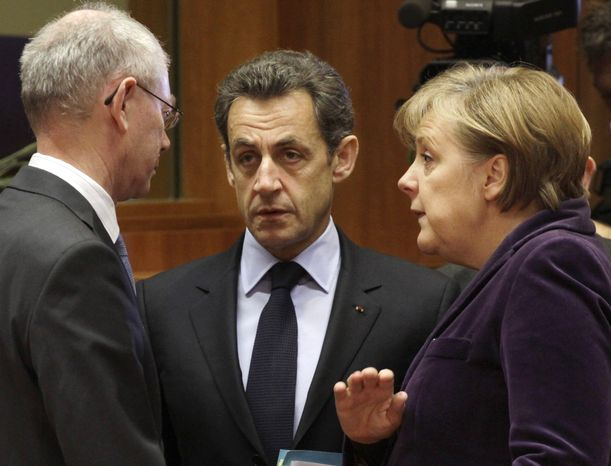 From left, European Council President Herman Van Rompuy, French President Nicolas Sarkozy and German Chancellor Angela Merkel participate in a round table discussion at an EU summit in Brussels, Friday, Feb. 4, 2011. EU leaders meet for a one-day summit on Friday, with energy, the eurozone debt crisis and unrest in Egypt set to dominate the agenda. (AP Photo/Yves Logghe)