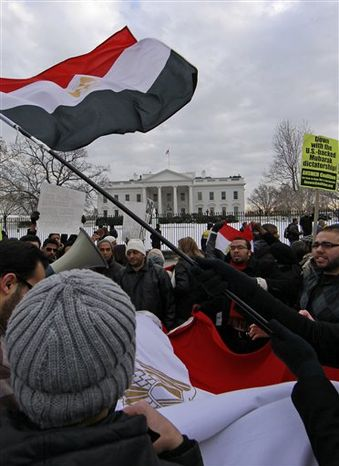 Egyptian flags wave during a Jan. 29 demonstration in front of the White House demanding that Egyptian President Hosni Mubarak step down. (Associated Press)