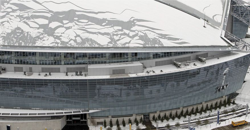 Sheets of broken ice and snow cover the roof of Cowboys Stadium, site of NFL football's Super Bowl XLV, on Friday, Feb. 4, 2011 in Arlington, Texas. Several people were injured, one critically, when ice fell from the roof of stadium on Friday, authorities said. (AP Photo/The Dallas Morning News, Louis DeLuca)