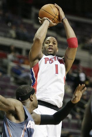 Detroit Pistons' Tracy McGrady (1) takes a shot over Charlotte Bobcats' Stephen Jackson in the second half of an NBA basketball game Wednesday, Feb. 2, 2011, in Auburn Hills, Mich. The Bobcats defeated the Pistons 97-87. (AP Photo/Duane Burleson)
