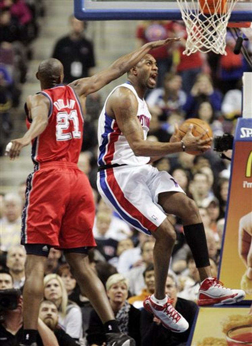 Detroit Pistons guard Richard Hamilton (32) drives on New Jersey Nets guard Sasha Vujacic (20), of Slovenia, in the second half of an NBA basketball game in Auburn Hills, Mich., Wednesday, April 6, 2011. Detroit won 116-109. (AP Photo/Paul Sancya)