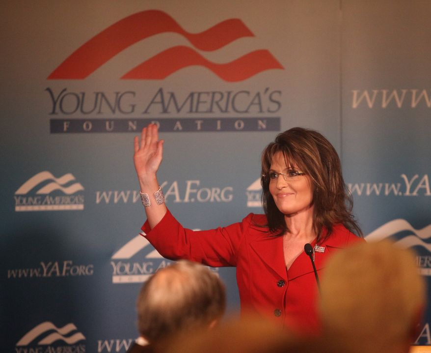 Former Alaska Gov. Sarah Palin, the 2008 GOP vice presidential nominee, receives a standing ovation as she arrives at the Reagan Ranch Center in Santa Barbara, Calif., on Friday Feb. 4, 2011. Mrs. Palin was the headline speaker for the Ronald Reagan Centennial celebration opening reception hosted by the Young Americans Foundation. (AP Photo/Spencer Weiner)
