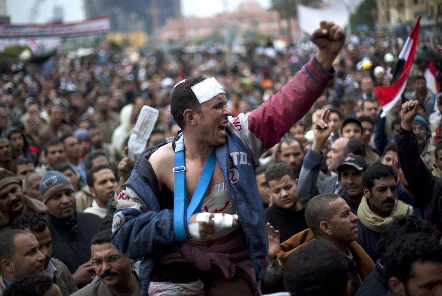 Egyptian anti-Mubarak protesters shout slogans during a demonstration in Tahrir square in Cairo, Egypt, on Saturday, Feb. 5, 2011. (AP Photo/Emilio Morenatti)