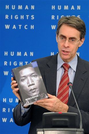 Human Rights Watch executive director Kenneth Roth shows the group's annual review during a media conference at the Residence Palace in Brussels, Monday, Jan. 24, 2011. Human Rights Watch released its annual review of human rights situations around the world, this year focusing on what it calls the silence and complicity of the U.S., U.N., EU and major European nations in dealing with rights-abusing developing nations. (AP Photo/Geert Vanden Wijngaert)