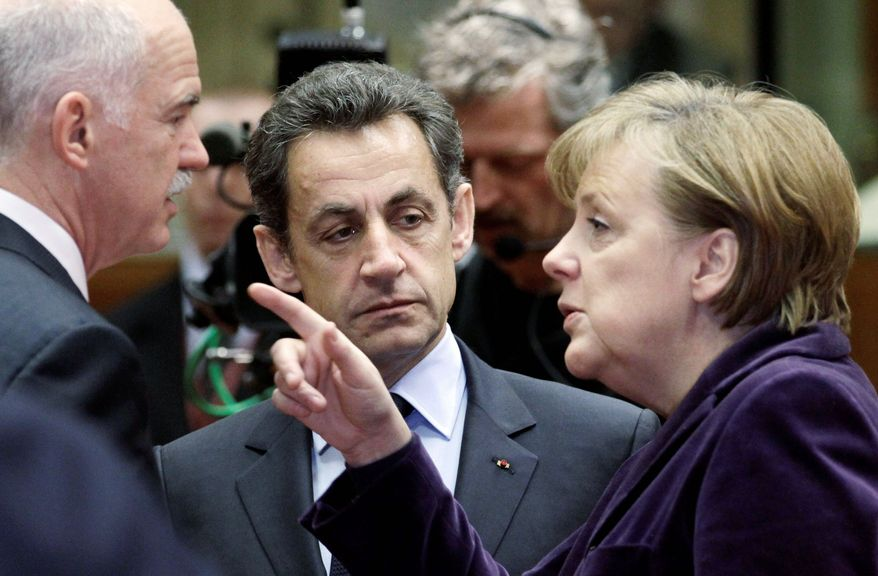 ASSOCIATED PRESS PHOTOGRAPHS German Chancellor Angela Merkel makes a point to Greek Prime Minister George Papandreou (left) and French President Nicolas Sarkozy during a European Union summit in Brussels on Friday.