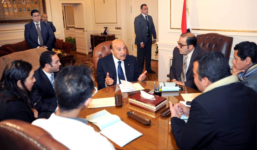 Egyptian Vice President Omar Suleiman (center) meets Sunday with representatives of the anti-government movement in Cairo to try to end the country's political crisis. The immediate ouster of President Hosni Mubarak continued to be a key demand.