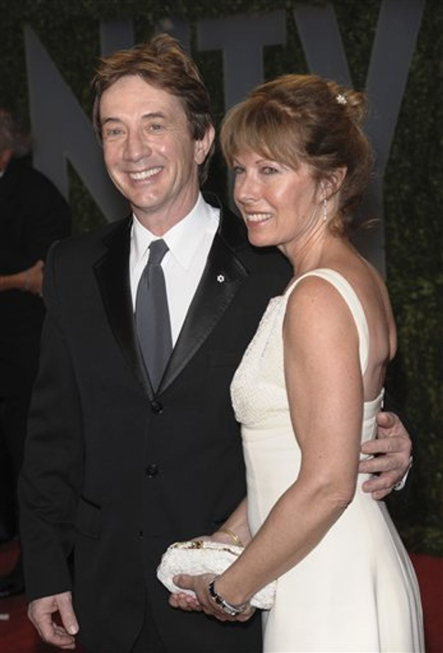 FILE - In this Feb. 22, 2009 file photo, actor Martin Short and his wife Nancy Dolman arrive at the Vanity Fair Oscar party in West Hollywood, Calif. (AP Photo/Evan Agostini, file)