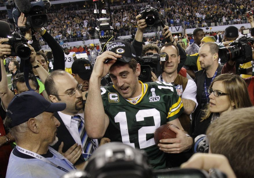 Green Bay Packers' Aaron Rodgers, center, celebrates his team's 31-25 win against the Pittsburgh Steelers after the NFL football Super Bowl XLV game on Sunday, Feb. 6, 2011, in Arlington, Texas. (AP Photo/Matt Slocum)