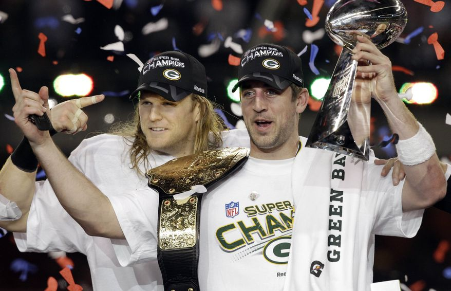 Green Bay Packers' Aaron Rodgers, right, poses with teammate Green Bay Packers' Clay Matthews after the NFL football Super Bowl XLV game against the Pittsburgh Steelers Sunday, Feb. 6, 2011, in Arlington, Texas. The Packers won the game 31-25. (AP Photo/Chris O'Meara)