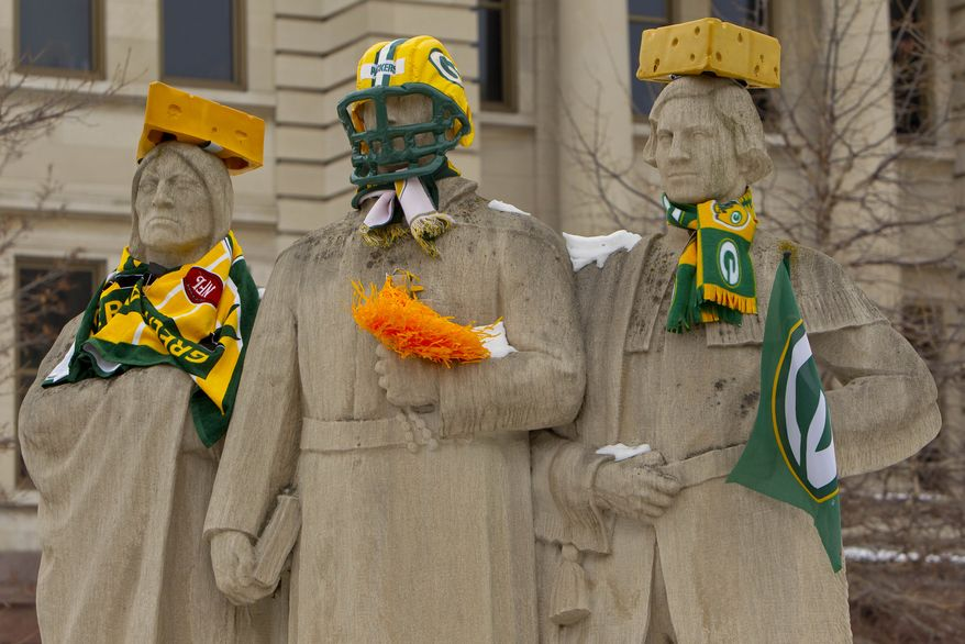 "The ""Spirit of Northwest"" statue in front of the Brown County Courthouse in Green Bay, Wis., is decorated for Sunday's Super Bowl XLV, in which the Green Bay Packers face the Pittsburgh Steelers. (AP Photo/Mike Roemer)"