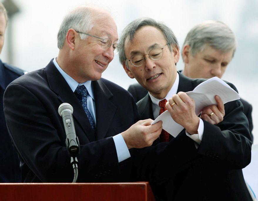 Interior Secretary Ken Salazar (left) and Energy Secretary Steven Chu look over a map of areas under consideration for wind energy development. Leasing of sites could begin by the end of the year. They made the announcement Monday morning. (Associated Press)