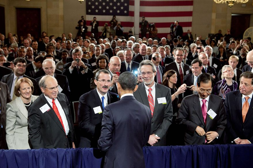 "President Obama greets members of the U.S. Chamber of Commerce on Monday after urging businesses to join him in an effort to change a ""burdensome"" corporate tax code and calling for ""something smarter, something simpler, something fairer."" (Bloomberg)"