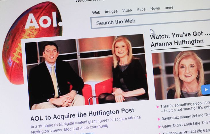 Headlines on AOL's website on Monday, Feb. 7, 2011, announce that the online company is buying online news hub Huffington Post. The $315 million deal represents a bold bet on the future of online news. (AP Photo/Mark Lennihan)