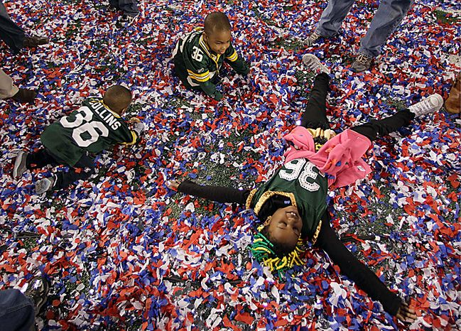 The children of the Green Bay Packers' Nick Collins play in the confetti on the field after the Packers' 31-25 win over the Pittsburgh Steelers in the NFL Super Bowl XLV football game on Sunday, Feb. 6, 2011, in Arlington, Texas. (AP Photo/Charlie Krupa)