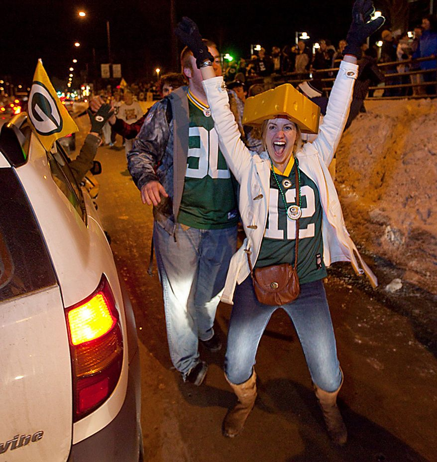 Green Bay Packers fans celebrate the Packers' 31-25 win in Super Bowl XLV on Sunday, Feb. 6, 2011, on Lombardi Avenue in front of Lambeau Field in Green Bay, Wis. (AP Photo/Mike Roemer)