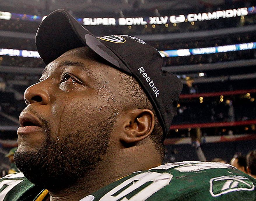 The Green Bay Packers' Howard Green reacts after beating the Pittsburgh Steelers 31-25 in the NFL football Super Bowl XLV game on Sunday, Feb. 6, 2011, in Arlington, Texas. (AP Photo/David J. Phillip)