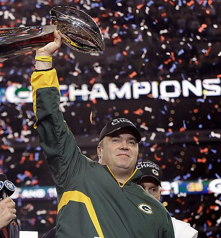 Green Bay Packers head coach Mike McCarthy holds the Vince Lombardi Trophy after beating the Pittsburgh Steelers 31-25 in the NFL Super Bowl XLV football game on Sunday, Feb. 6, 2011, in Arlington, Texas. (AP Photo/David J. Phillip)