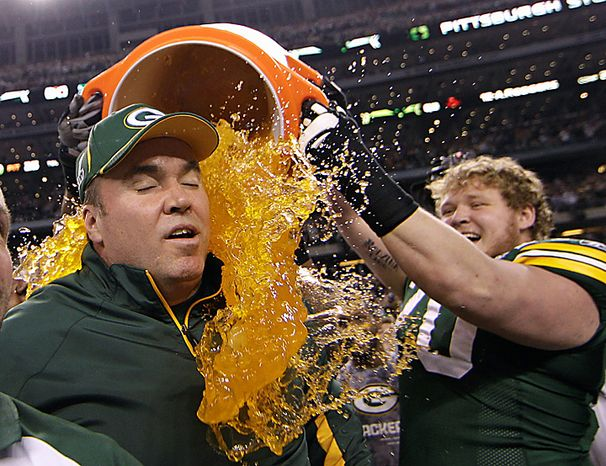 Green Bay Packers head coach Mike McCarthy is dunked with Gatorade by T.J. Lang after their 31-25 victory over the Pittsburgh Steelers in the NFL football Super Bowl XLV game on Sunday, Feb. 6, 2011, in Arlington, Texas. (AP Photo/David J. Phillip)