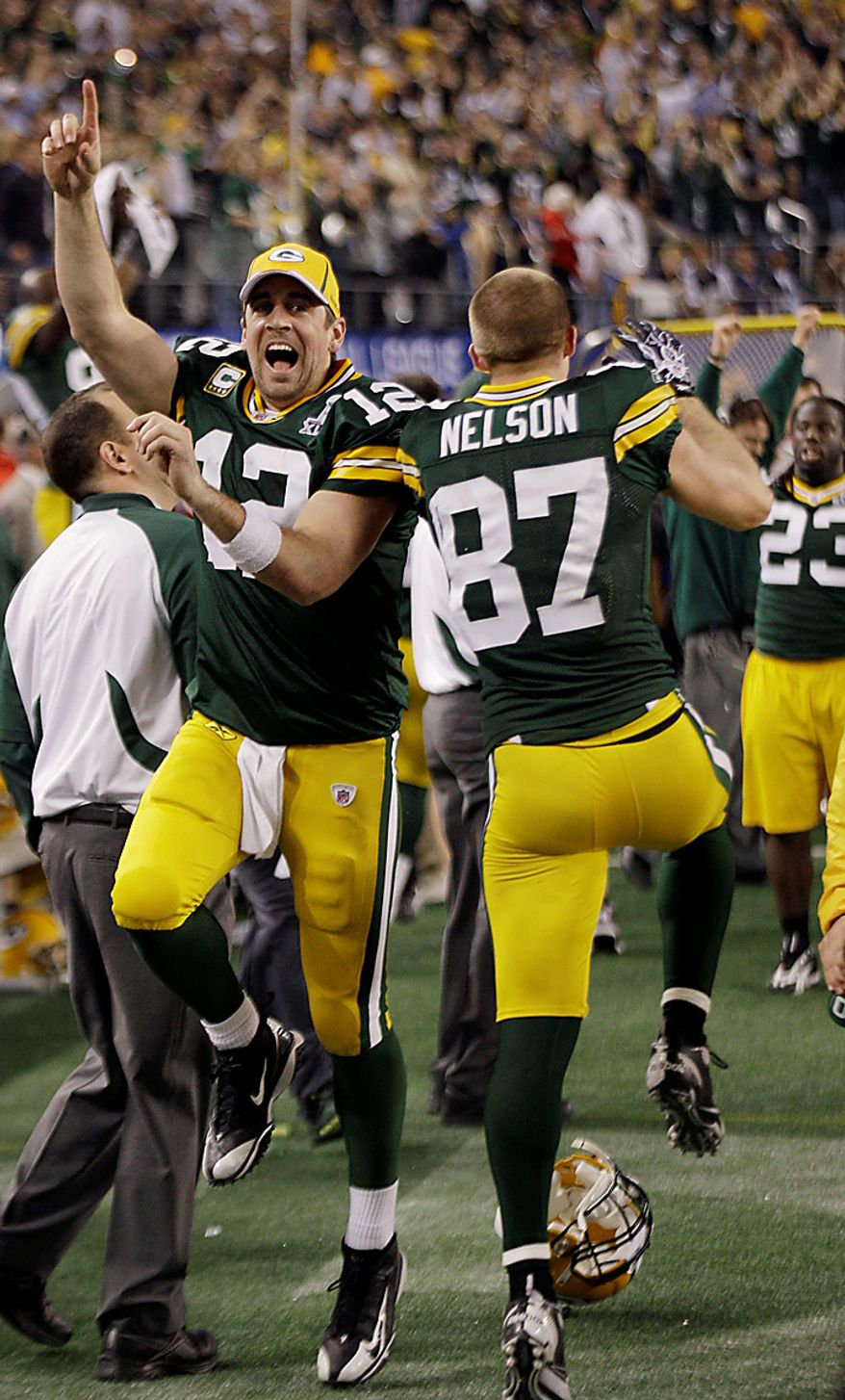 The Green Bay Packers' Aaron Rodgers, left, and teammate Jordy Nelson (87) celebrate after the Packers beat the Pittsburgh Steelers in the NFL football Super Bowl XLV game on Sunday, Feb. 6, 2011, in Arlington, Texas. The Packers won 31-25. (AP Photo/David J. Phillip)
