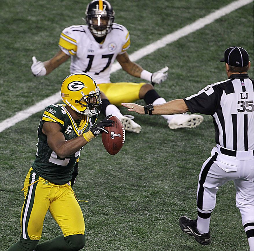The Green Bay Packers' Jarrett Bush celebrates after the Pittsburgh Steelers' Mike Wallace (17) failed to catch a pass on the Steelers' final possession during the second half of the NFL Super Bowl XLV football game on Sunday, Feb. 6, 2011, in Arlington, Texas. The Packers won the game 31-25.  (AP Photo/Lynne Sladky)