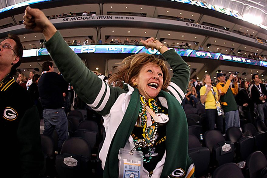 Green Bay Packers fans react during the NFL Super Bowl XLV football game against the Pittsburgh Steelers on Sunday, Feb. 6, 2011, in Arlington, Texas. The Packers won 31-25. (AP Photo/Charlie Riedel)