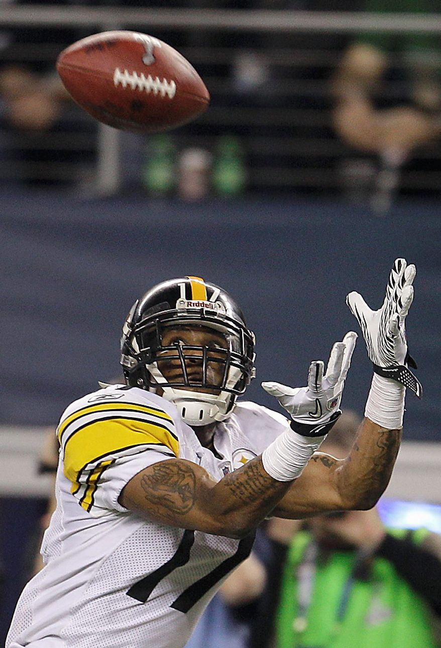 The Pittsburgh Steelers' Mike Wallace catches a 25-yard touchdown pass during the fourth quarter of the NFL football Super Bowl XLV game against the Green Bay Packers on Sunday, Feb. 6, 2011, in Arlington, Texas. (AP Photo/Matt Slocum)