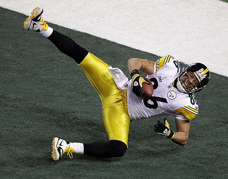 The Pittsburgh Steelers' Hines Ward comes down with a touchdown reception in the end zone during the first half of the NFL Super Bowl XLV football game against the Green Bay Packers on Sunday, Feb. 6, 2011, in Arlington, Texas. (AP Photo/Charlie Riedel)