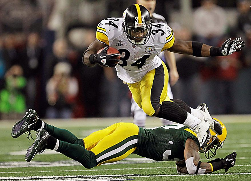 The Pittsburgh Steelers' Rashard Mendenhall rushes past the Green Bay Packers' Sam Shields during the second half of the NFL Super Bowl XLV football game on Sunday, Feb. 6, 2011, in Arlington, Texas. (AP Photo/Charlie Krupa)