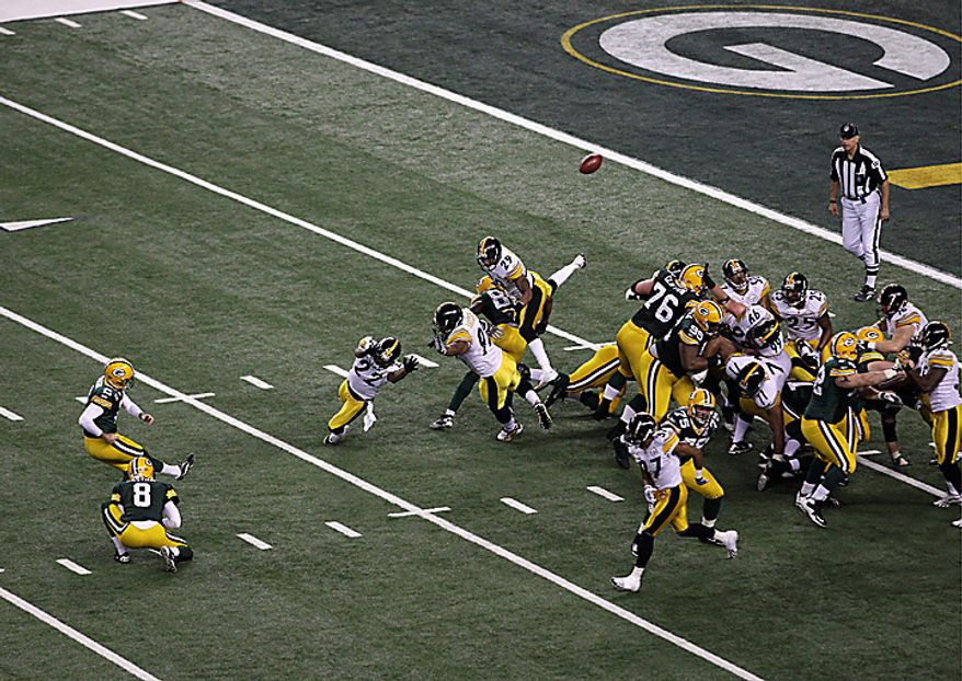 The Green Bay Packers' Mason Crosby (2), left, kicks a field goal as Tim Masthay (8) holds on the play in the second half of the NFL Super Bowl XLV football game against the Pittsburgh Steelers on Sunday, Feb. 6, 2011, in Arlington, Texas. (AP Photo/Charlie Riedel)