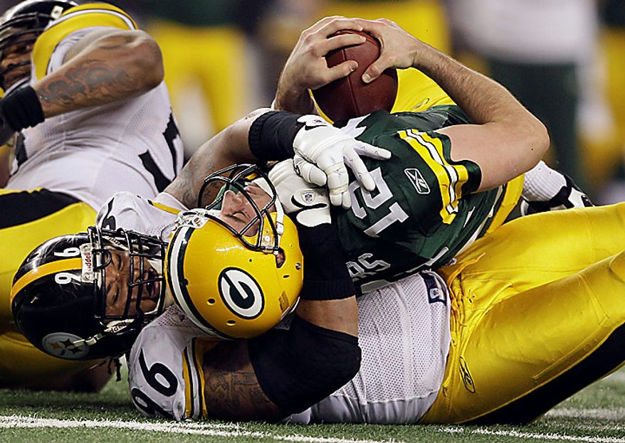 The Green Bay Packers' Aaron Rodgers is sacked by the Pittsburgh Steelers' Ziggy Hood during the second half of the NFL Super Bowl XLV football game on Sunday, Feb. 6, 2011, in Arlington, Texas. (AP Photo/Charlie Krupa)