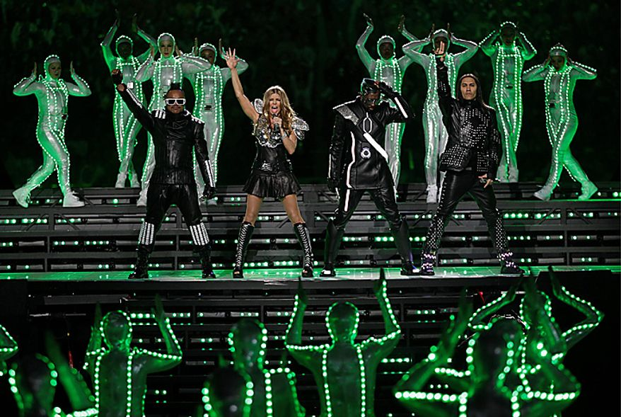 The Black Eyed Peas, along with (from left) apl.de.ap, will.i.am, Fergie and Taboo, perform during halftime of the NFL Super Bowl XLV on Sunday, Feb. 6, 2011, in Arlington, Texas. (AP Photo/Charlie Krupa)