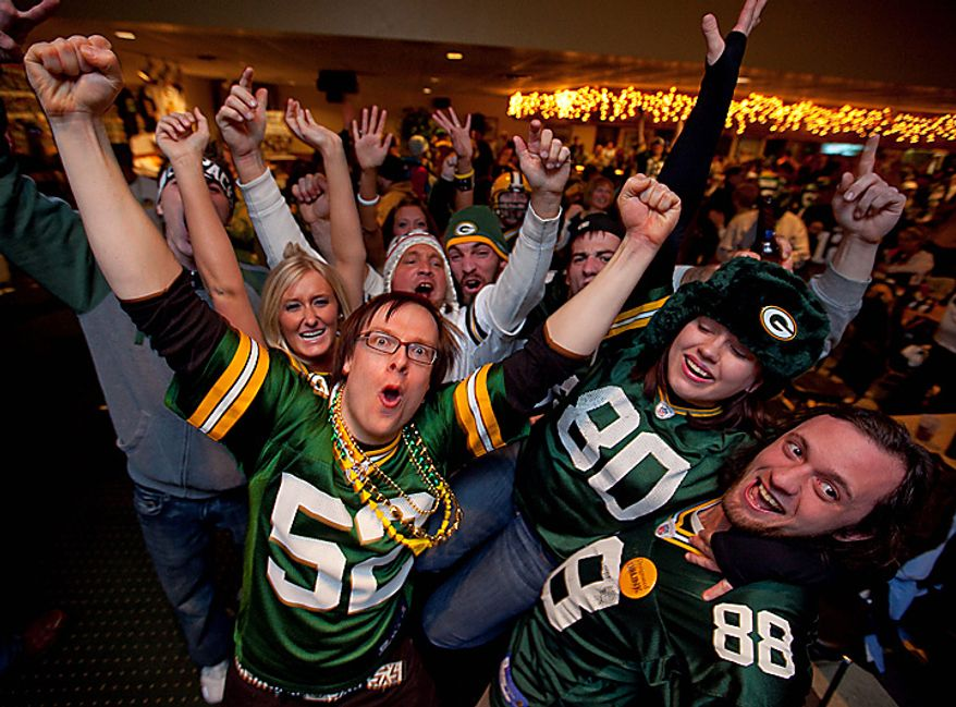 Green Bay Packers fans celebrate on Sunday, Feb. 6, 2011, at the Stadium View Bar near Lambeau Field in Green Bay, Wis., after the Packers won Super Bowl XLV. The Packers defeated the Pittsburgh Steelers 31-25 for the NFL's championship title. (AP Photo/Mike Roemer)