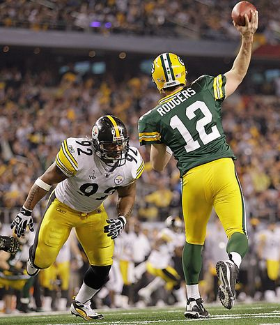 The Pittsburgh Steelers' James Harrison (92) pressures the Green Bay Packers' Aaron Rodgers during the second half of the NFL Super Bowl XLV game on Sunday, Feb. 6, 2011, in Arlington, Texas. (AP Photo/Paul Sancya)