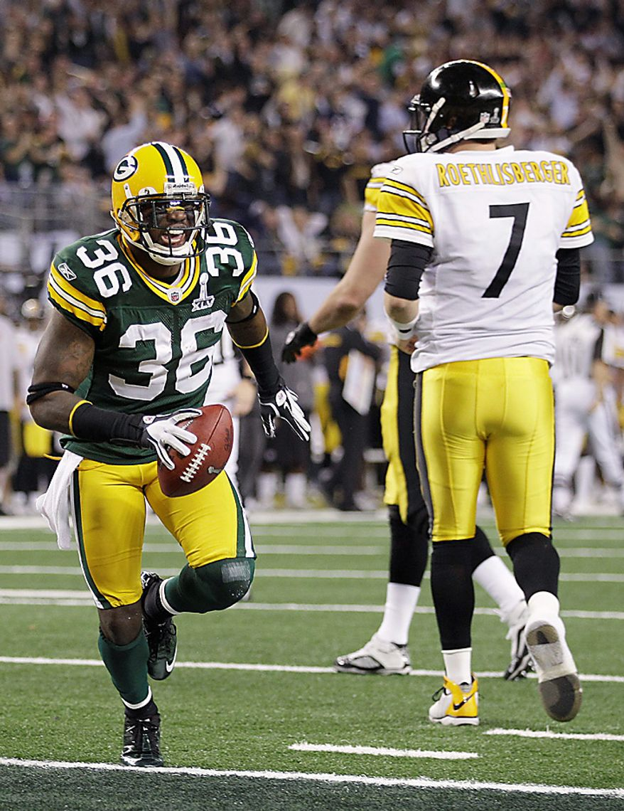 The Green Bay Packers' Nick Collins (36) celebrates in front of the Pittsburgh Steelers' Ben Roethlisberger (7) after returning an interception for a touchdown during the first quarter of the NFL Super Bowl XLV game on Sunday, Feb. 6, 2011, in Arlington, Texas. (AP Photo/Paul Sancya)