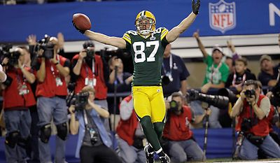 The Green Bay Packers' Jordy Nelson celebrates after he scored a touchdown against the Pittsburgh Steelers during the first half of the NFL Super Bowl XLV game on Sunday, Feb. 6, 2011, in Arlington, Texas. (AP Photo/Eric Gay)
