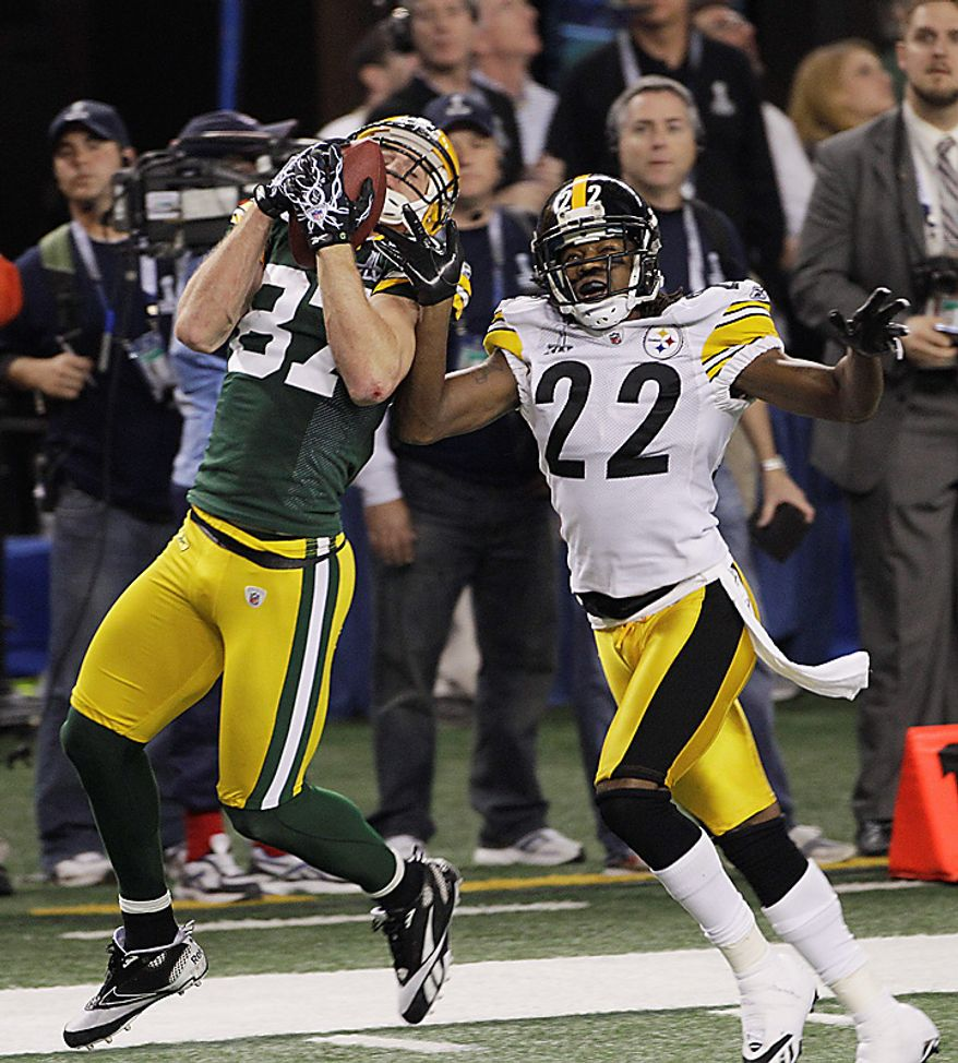 The Green Bay Packers' Jordy Nelson (87) catches the ball for a touchdown against the Pittsburgh Steelers' William Gay (22) in the first half of the NFL Super Bowl XLV football game on Sunday, Feb. 6, 2011, in Arlington, Texas. (AP Photo/Marcio Jose Sanchez)