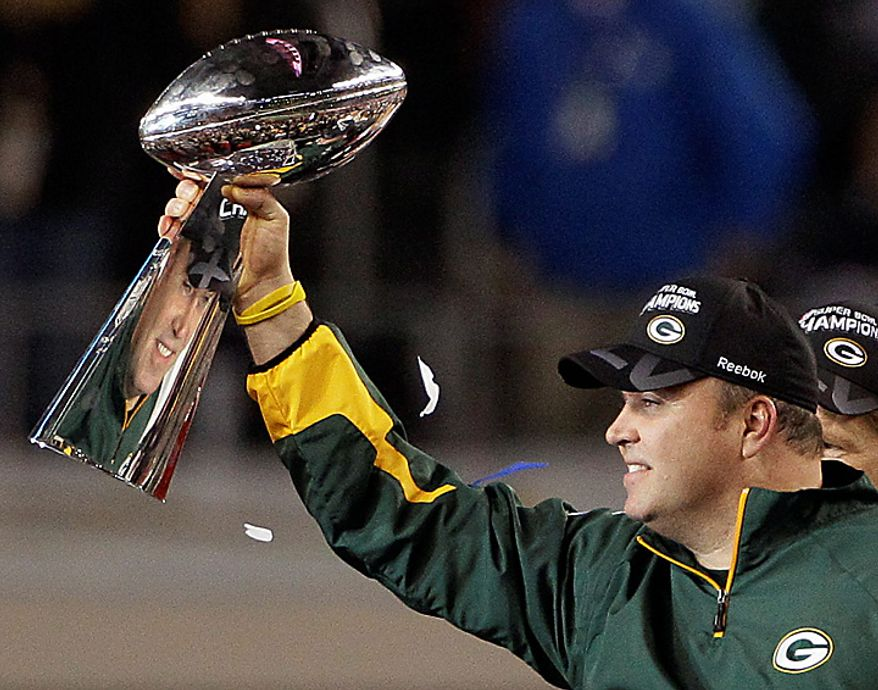 Green Bay Packers head coach Mike McCarthy holds the Vince Lombardi Trophy after the Packers beat the Pittsburgh Steelers 31-25 in the NFL Super Bowl XLV football game on Sunday, Feb. 6, 2011, in Arlington, Texas. (AP Photo/Patrick Semansky)