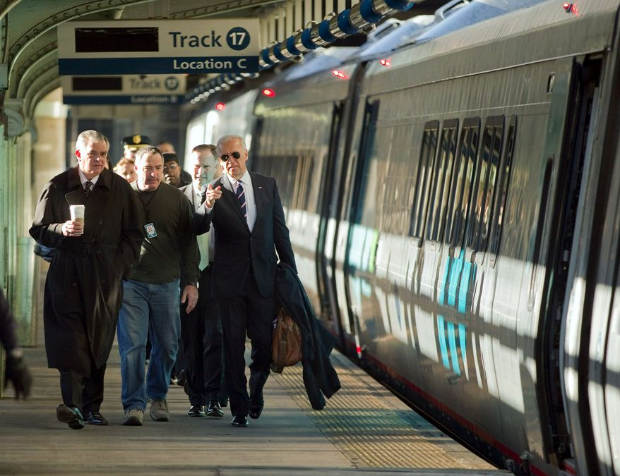 Vice President Joseph R. Biden Jr. (right) walks with Transportation Secretary Ray LaHood (left) to a train at Union Station in Washington on Tuesday. They traveled to Philadelphia to tout plans for the nation's infrastructure. (Associated Press)
