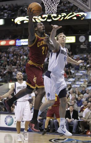 Cleveland Cavaliers power forward J.J. Hickson (21) shoots against Dallas Mavericks power forward Dirk Nowitzki (41) during the first half of a NBA basketball game in Dallas on Monday, Feb. 7, 2011. (AP Photo/LM Otero)