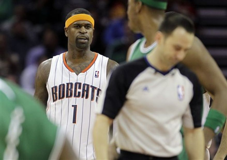 Charlotte Bobcats' Stephen Jackson (1) reacts after being called for a technical foul by referee Mark Ayotte, right, in the first half of an NBA basketball game against the Boston Celtics in Charlotte, N.C., Monday, Feb. 7, 2011. Jackson was ejected from the game after arguing the call. (AP Photo/Chuck Burton)