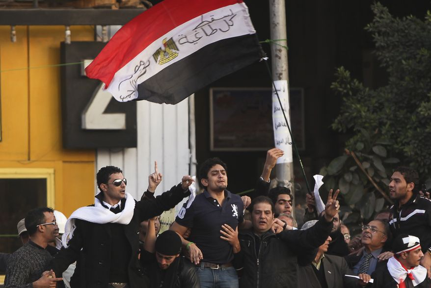 """Wael Ghonim (center), the 30-year-old Google Inc. marketing manager who was a key organizer of the online campaign that sparked the first Egyptian protest on Jan. 25, talks to the crowd in Tahrir Square in Cairo on Tuesday, Feb. 8, 2011. Newly released from detention, Mr. Ghonim was greeted by cheers, whistling and thunderous applause when he declared, """"We will not abandon our demand, and that is the departure of the regime."""" (AP Photo/Tara Todras-Whitehill)"""